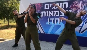 A still image from the short video that went viral, of Israeli singer Noa Kirel performing at an army base in central Israel on Independence Day, accompanied by two backup dancers in uniform.