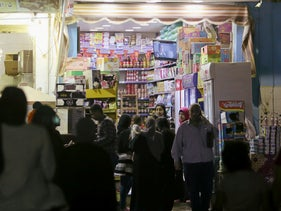 People gather in front of a shop during curfew hours in Cairo, Egypt May 5, 2020.