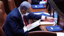 Netanyahu votes digitally at the Knesset plenum in Jerusalem, May 6, 2020
