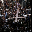 Worshippers carry a cross into the Church of the Holy Sepulcher during the Good Friday procession in Jerusalem's Old City March 25, 2016.
