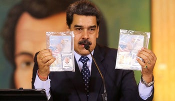 Personal documents are shown by Venezuela's President Nicolas Maduro during a virtual news conference in Caracas, Venezuela May 6, 2020