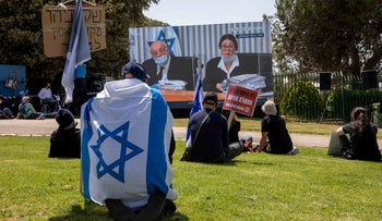 Protesters watch the High Court hearing streamed live in Jerusalem, May 3, 2020.