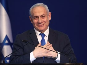 Israeli Prime Minister Benjamin Netanyahu addresses his supporters after first exit poll results for Israeli elections in Tel Aviv, Israel, March 2, 2020.