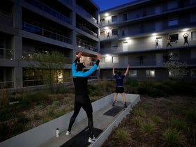 Residents exercise on their balconies following fitness trainers as a lockdown is imposed to slow the spread of the coronavirus in Nantes, France, March 27, 2020.