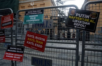 """""""Putin get out of Libya with Haftar!"""" - Placards are attached on security barriers outside the Russian Consulate during a protest against Russia in Istanbul, Turkey, February 29, 2020."""