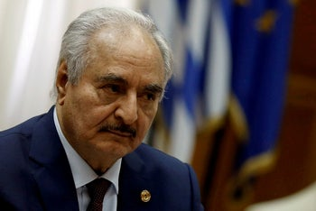 Libyan commander Khalifa Haftar meets Greek Prime Minister Kyriakos Mitsotakis (not pictured) at the Parliament in Athens, Greece, January 17, 2020.