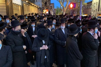 Hundreds of mourners gather in Brooklyn, on Tuesday, April 28, 2020, to observe a funeral for Rabbi Chaim Mertz, a Hasidic Orthodox leader whose death was reportedly tied to the coronavirus.