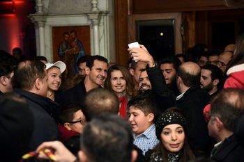 Bashar Assad and his wife Asma in a Christmas choral presentation at the Lady of Damascus Catholic Church, 18, 2015.