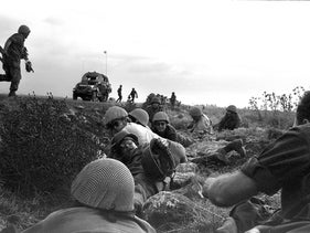 Israeli soldiers taking cover from Syrian bombers in the Golan Heights during the Yom Kippur War, October 1973.