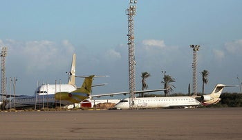 Planes are seen after the reopening of Mitiga Airport in Tripoli, Libya  December 12, 2019.