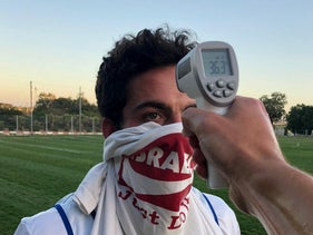 Taking temperature before Israel's national lacrosse squad practice at Wingate Institute, May 4, 2020.