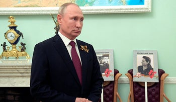 Russian President Vladimir Putin at the Immortal Regiment rally marking the 75th anniversary of the victory over Nazi Germany in WWII, at the Kremlin in Moscow, May 9, 2020.