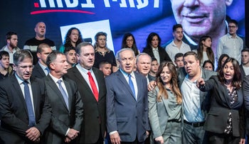 Prime Minister Benjamin Netanyahu, flanked by Likud MKs, at a campaign event during the last round of elections in Ramat Gan, February 29, 2020.