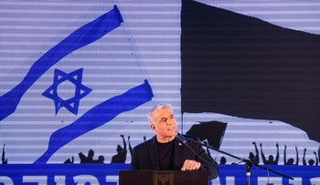 Yair Lapid speaks at a demonstration against Netanyahu being allowed to form a government at Rabin Square, Tel Aviv, April 19, 2020