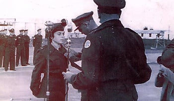 In this archive photo, Batya Varonsky-Orny receives pilot wings from then Chief of General Staff, Moshe Dayan, In 1954.