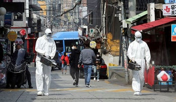 Quarantine workers spray disinfectants at night spots of Itaewon neighborhood, following the coronavirus disease (COVID-19) outbreak, in Seoul, South Korea, May 11, 2020