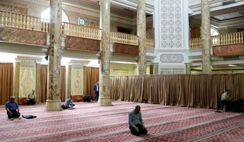 Iranian worshipers pray as they keep social distancing at a mosque following the outbreak of the COVID-19, in Tehran, Iran, April 30, 2020.