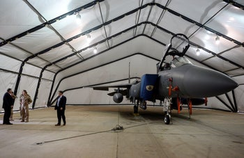 US Secretary of State Mike Pompeo inspects an F-15E Strike Eagle at Prince Sultan air base in Saudi Arabia on a trip to discuss security concerns about Iran. Feb. 20, 2020