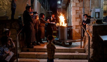 A group of people around a bonfire, Mea Shearim, Jerusalem, May 10, 2020.