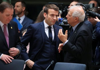 EU High Representative for Foreign Affairs, Josep Borrell (R) and French President Emmanuel Macron at  the EU headquarters in Brussels, February 20, 2020.