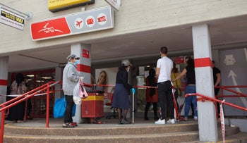 People standing in line to get subsistence allowances in Be'er Sheva, southern Israel, April 2020.