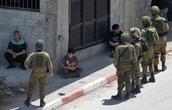 Israeli soldiers detain Palestinians in the village of Ya'bad near the West Bank city of Jenin, May 12, 202