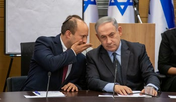 Bennett speaks to Netanyahu during a meeting of the right-wing parties, March 4, 2020.
