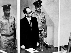 The 1961 file photo shows Adolf Eichmann standing in his glass cage, flanked by guards, in the Jerusalem courtroom during his trial in 1961 for war crimes committed during World War II.