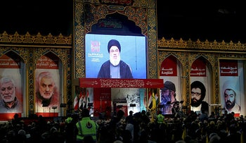 Lebanon's Hezbollah leader Sayyed Hassan Nasrallah addresses his supporters through a screen in Beirut's southern suburbs, Lebanon February 16, 2020.
