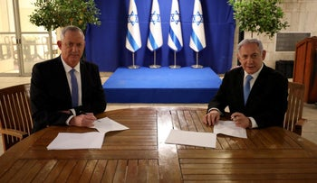Netanyahu and Gantz signing the unity agreement in Jerusalem, April 2020