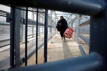 A Palestinian man working in Israel heads to work through an Israeli checkpoint near Hebron, West Bank March 18, 2020.