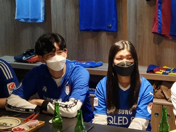 Fans of South Korea's football club Suwon Samsung Bluewings watch a live broadcast of the opening match of 2020 K League 1 at a pub in Suwon, South Korea, May 8, 2020.