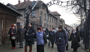 Holocaust survivors walking through the gates at Auschwitz in 2016. Two-thirds of American millennials said they had never heard of the Nazi death camp in a 2018 survey.