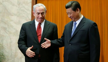 Netanyahu prepares to shake hands with China's President Xi Jinping at the Great Hall of the People in Beijing, May 9, 2013