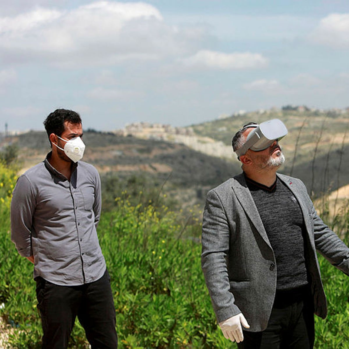 A man wearing a Virtual Reality device tries Palestine VR, in Ramallah, April 23, 2020.