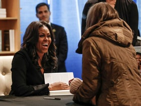 Former first lady Michelle Obama signs copies of her memoir Becoming at the Seminary Co-op Bookstore in Chicago, Illinois, U.S., November 13, 2018.