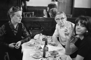 Jean-Paul Sartre, French writer Simone de Beauvoir (L) and French lawyer Gisele Halimi have lunch at a restaurant in Paris on May 27, 1970
