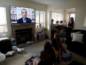 Students watch former U.S. President Barack Obama deliver a virtual commencement speech, California, May 16, 2020