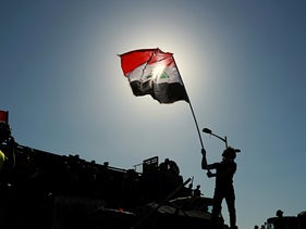 A protester holds an Iraqi flag in Baghdad, May 12, 2020