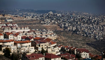 The Israeli settlement of Efrat (L) in the Gush Etzion settlement block as Bethlehem is seen in the background, in the West Bank, January 28, 2020.