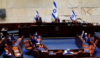 Benny Gantz speaks at the podium in the Knesset during the swearing in ceremony for the new government on May 17, 2020.