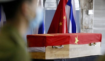 Israeli soldiers stand beside the flag-draped coffin of Chinese ambassador Du Wei during a ceremony at Ben-Gurion International Airport, May 20, 2020.