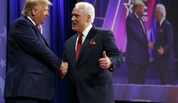 President Donald Trump is greeted by Matt Schlapp, Chairman of the American Conservative Union, as he arrives to speak at the Conservative Political Action Conference in Oxon Hill, Maryland, February 29, 2020.