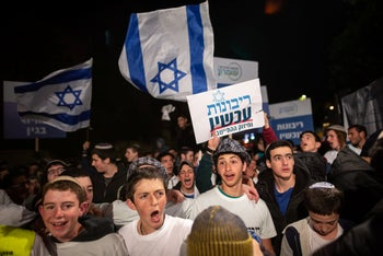 Israeli right-wing demonstration calling for immediate West Bank annexation with placards reframing the 'Peace Now' slogan to 'Annexation Now.' Jerusalem, 8 May 2020