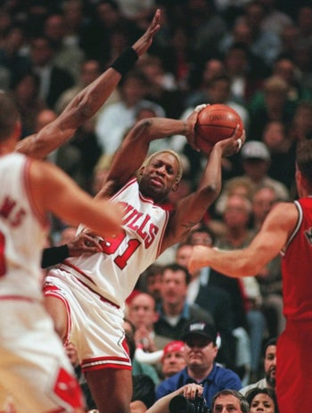 Chicago Bulls' Dennis Rodman (91) grabbing a rebound against the Miami Heat during the third quarter of Game 1 of the Eastern Conference finals, May 20, 1997.