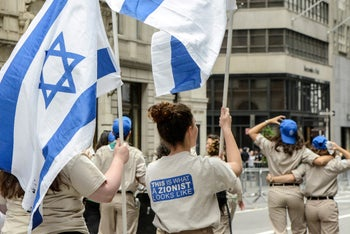 """A participant wears a shirt that reads """"This is what a Zionist looks like"""" during the """"Celebrate Israel"""" parade along 5th Ave. in New York City, U.S., June 4, 2017"""