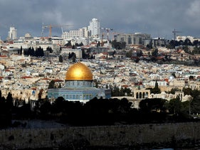The Dome of the Rock in central Jerusalem and high-rise construction sites beyond it, March 20, 2020.
