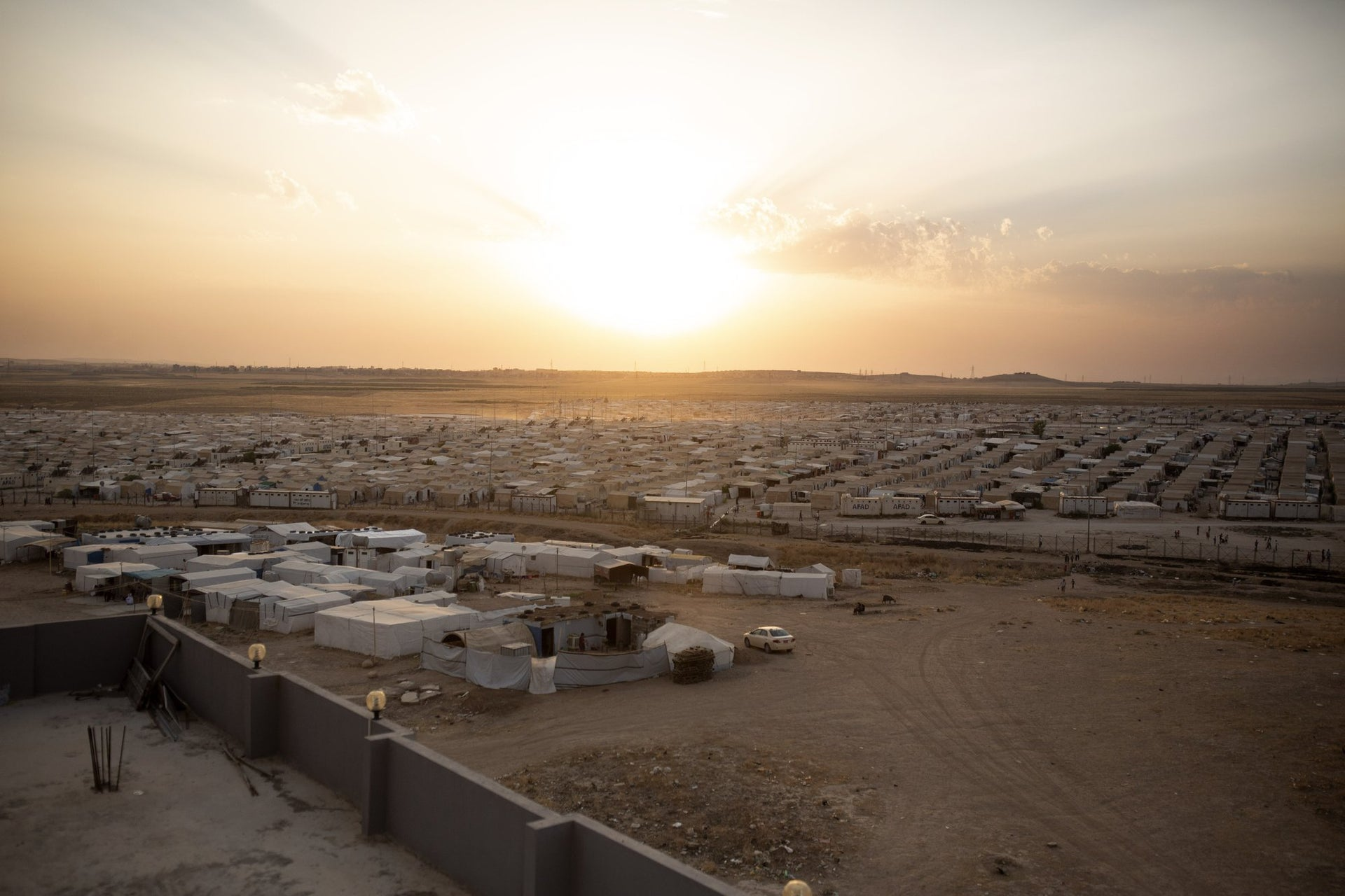 The sun sets over Sharia Camp, where Yazidis displaced by Islamic State militants are housed near Dohuk, Iraq.