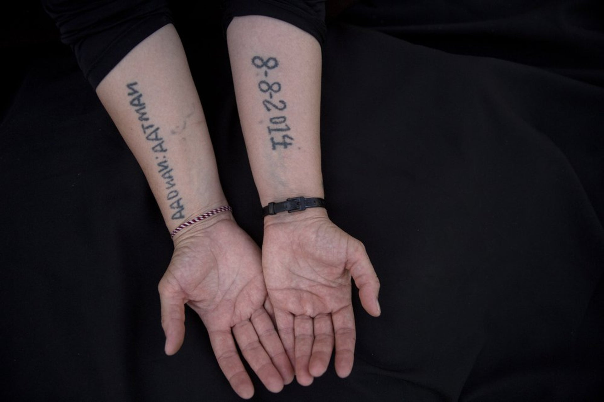 Leila Shamo displays tattoos she made while enslaved by Islamic State militants at her home near Khanke Camp, near Dohuk, Iraq, August 29, 2019.