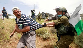 clashes at a protest against Israeli plan to annex parts of the West Bank, May 15, 2020.